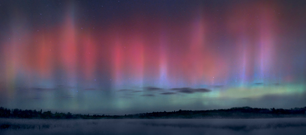Pink, blue, and green aurora borealis over the BWCA