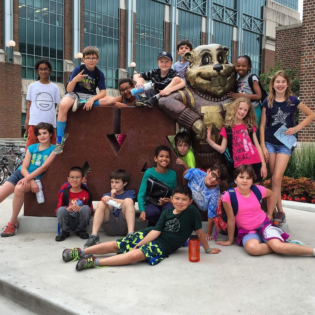 group of elementary students posed at the large maroon M at the University of MN