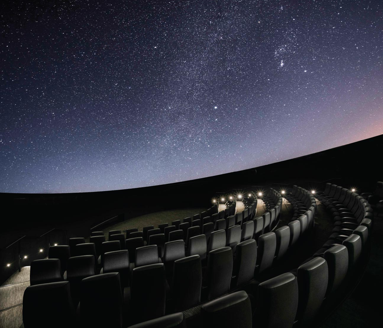 Planetarium theater with starry sky on the dome
