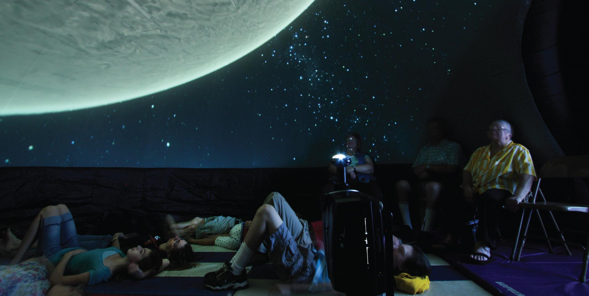 School kids stargaze inside the ExploraDome