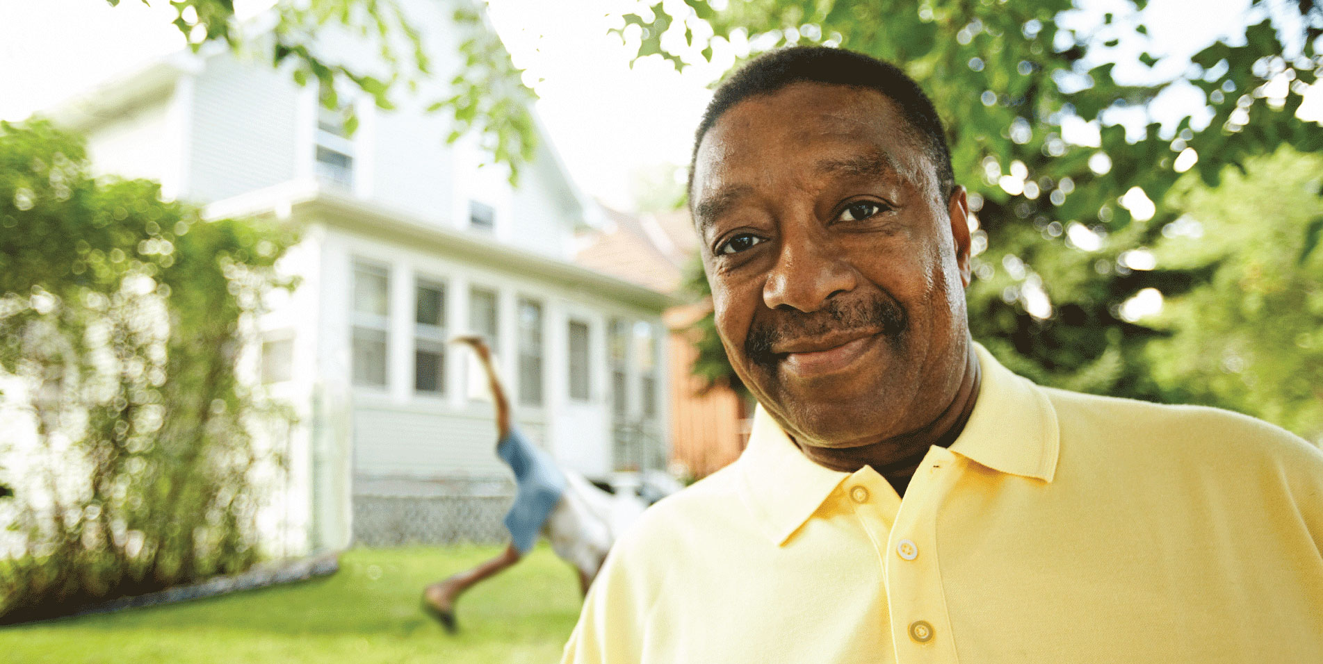 Local retiree outside his home