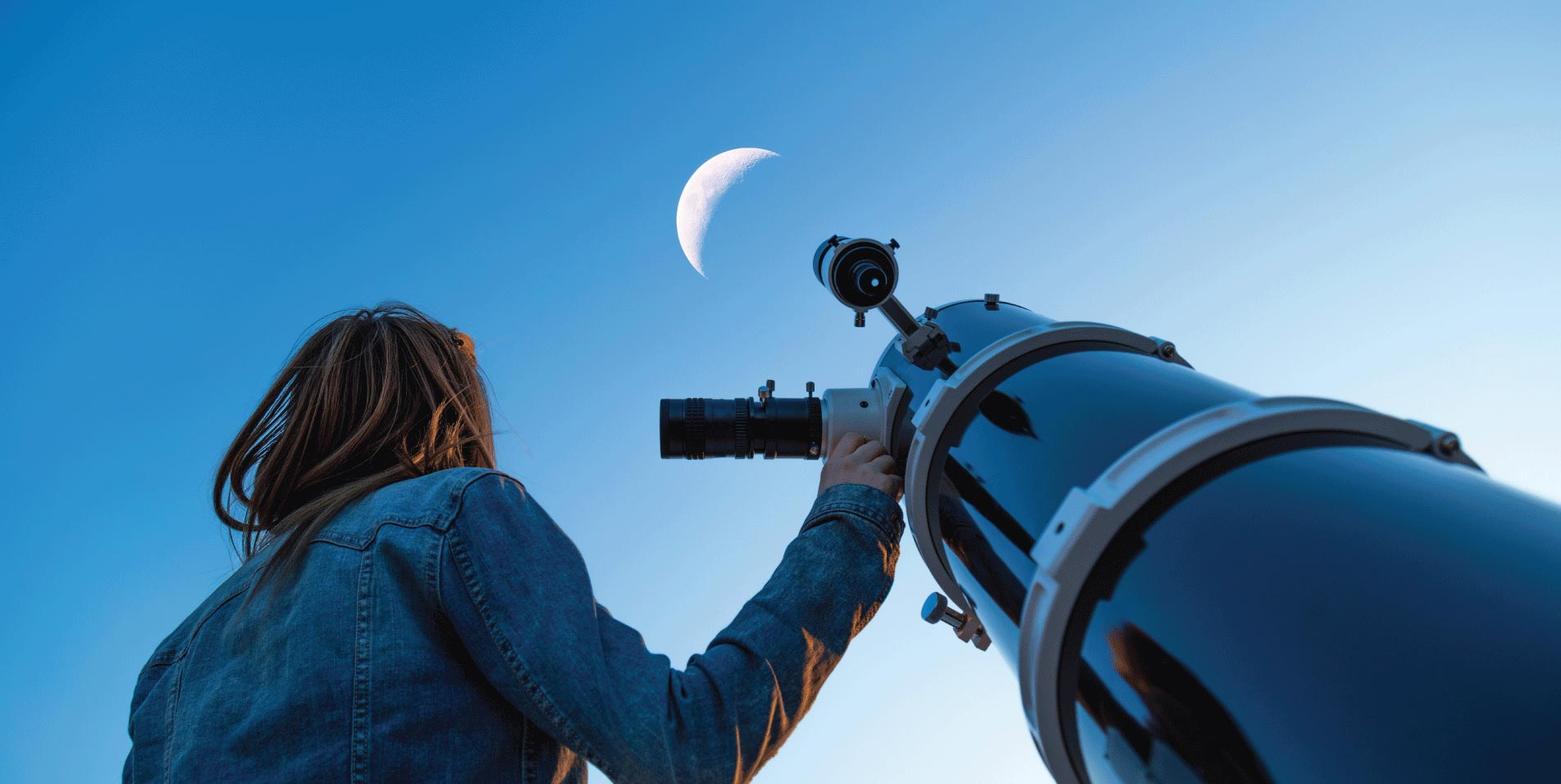 Woman stargazing with telescope