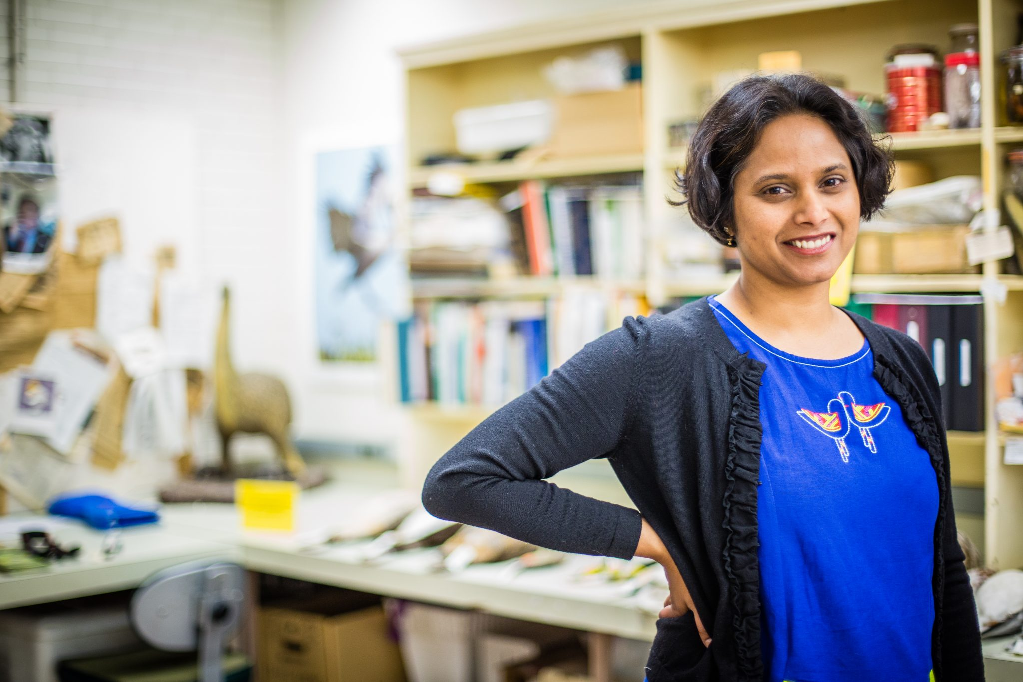 A portrait of Dr Sushma Reddy, new Breckenridge Chair of Ornithology, in her office