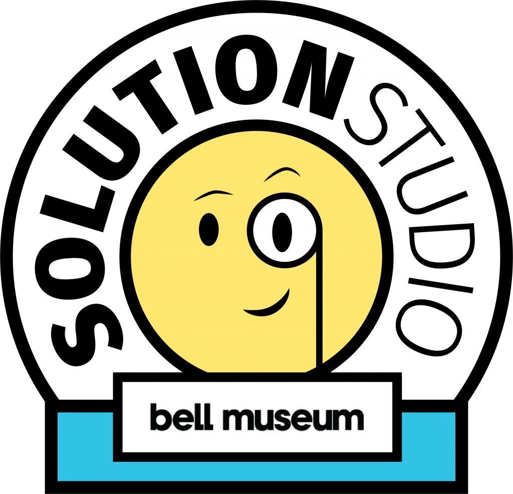 Solution Studio Graphic with a smily face looking through a magnifyer