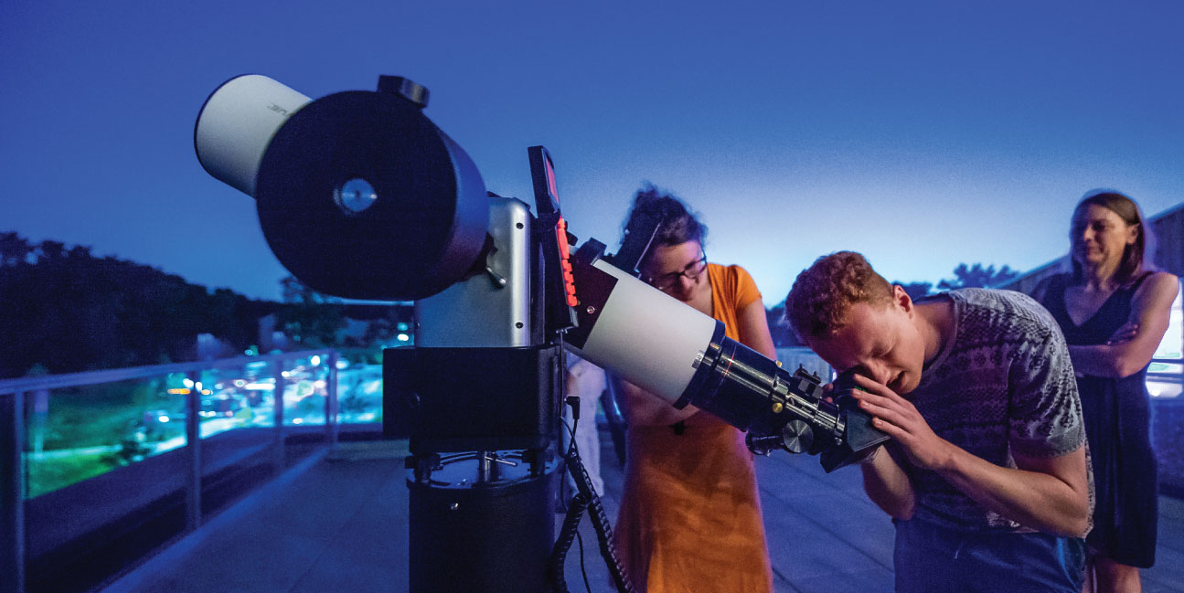 People stargazing with a telescope at the Bell Museum