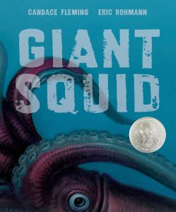 """Image from the cover of a children's book, """"Giant Squid,"""" showing a close-up of some large tentacles on a blue background of water"""