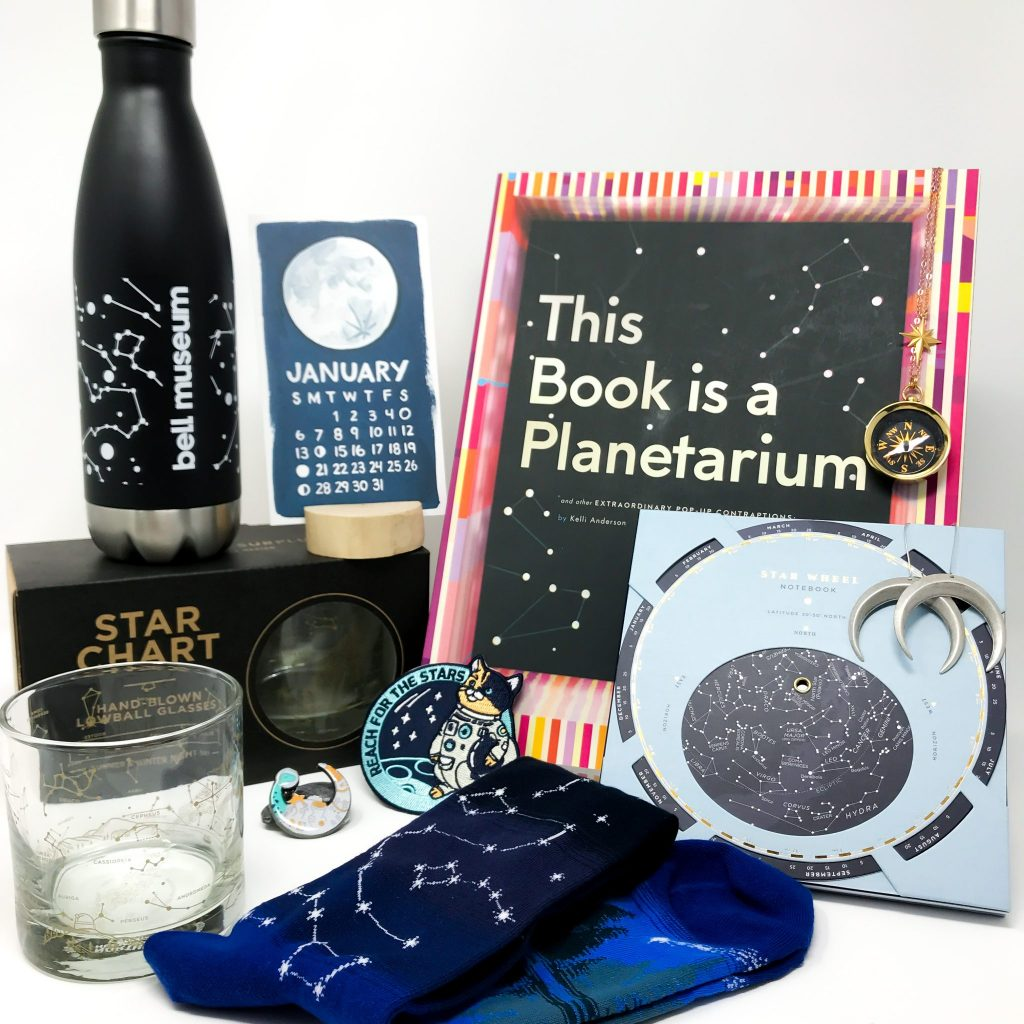 Various space-related items from the museum shop arranged together.