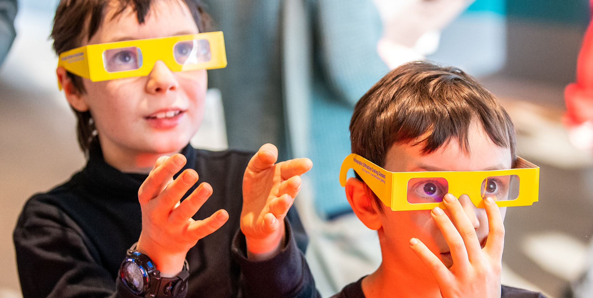 Two boys using special glasses to see infrared light
