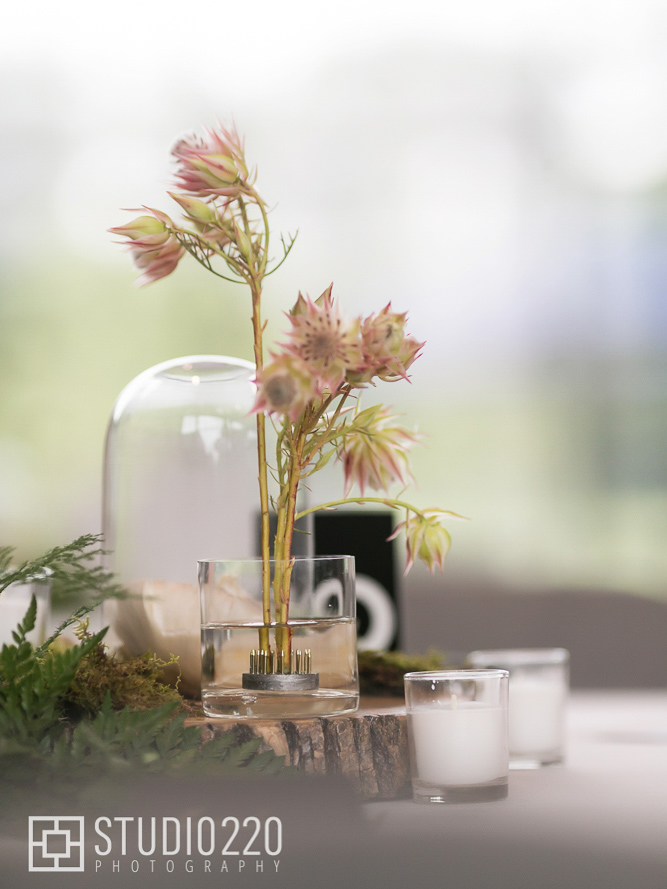Centeripiece for wedding with candles, flowers, ferns and lichens