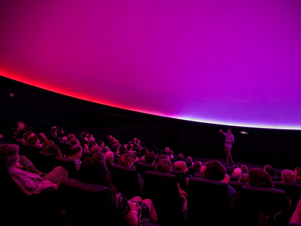 Guests in the planetarium watching a live presentation