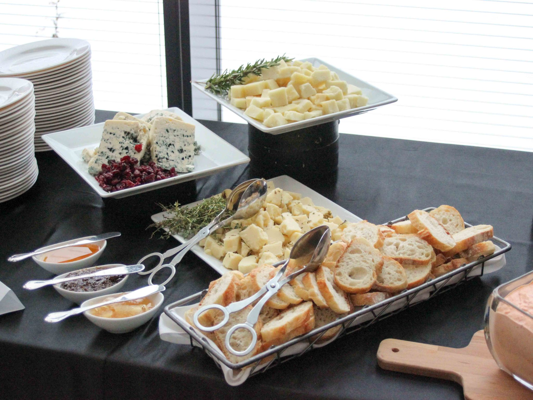 Close up of breads, cheeses and dips on buffet table
