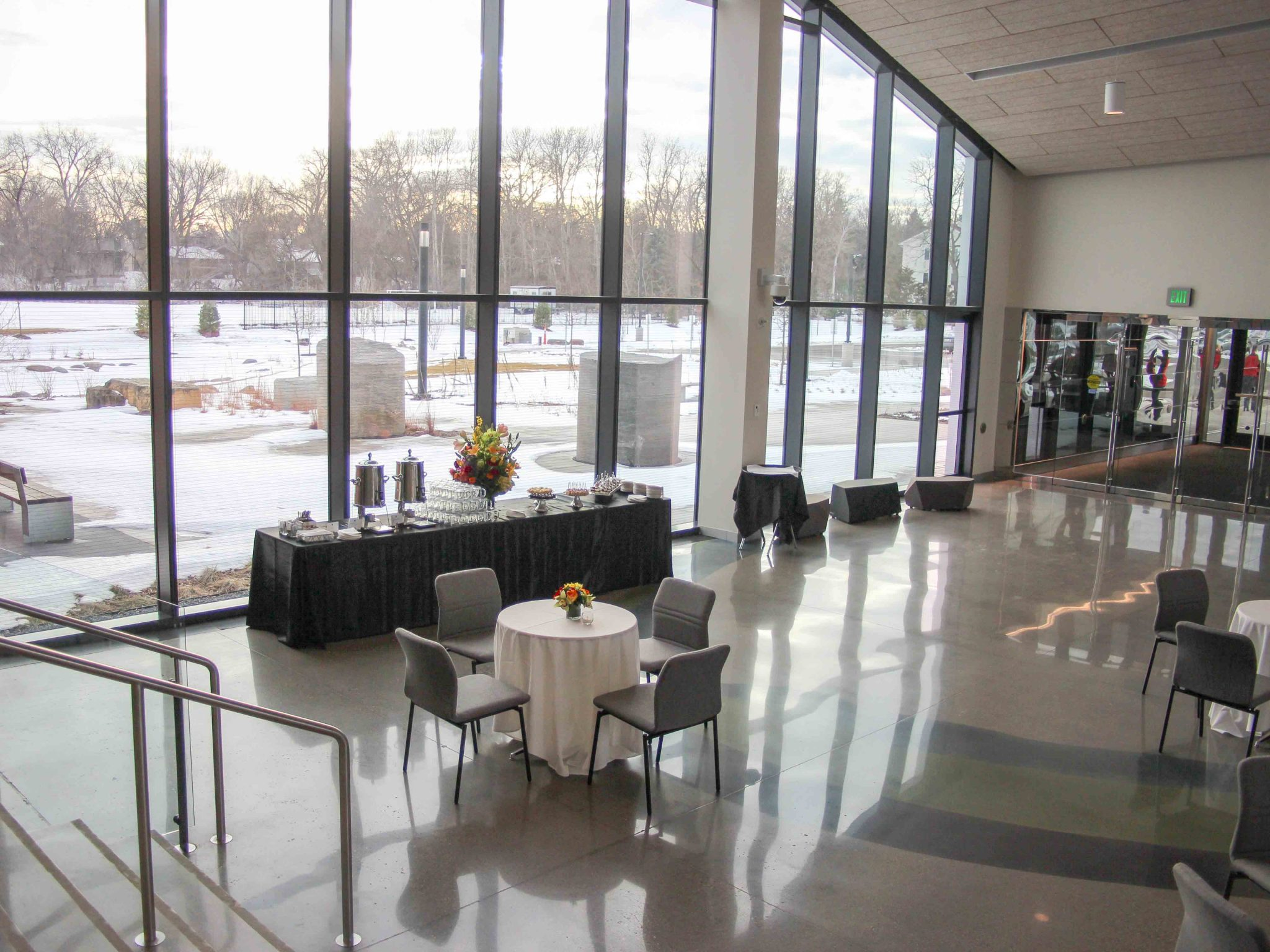 Buffet table and small seating tables set up in large hall
