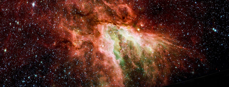 Red, orange, green nebula and stars