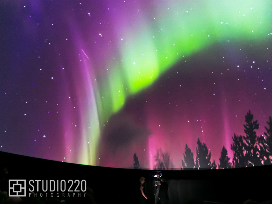 An image of the aurora borealis projected onto the planetarium screen