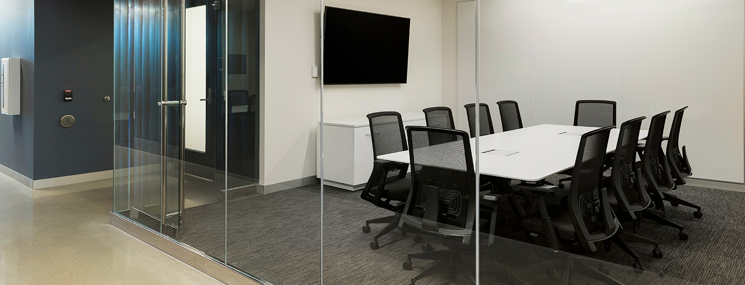 Small conference room set for 10 around a rectangular table