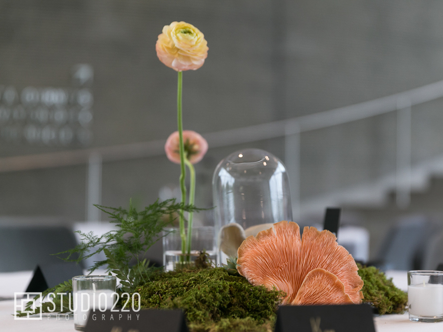 Wedding centerpiece with lichens, ferns, flowers and pink fungus