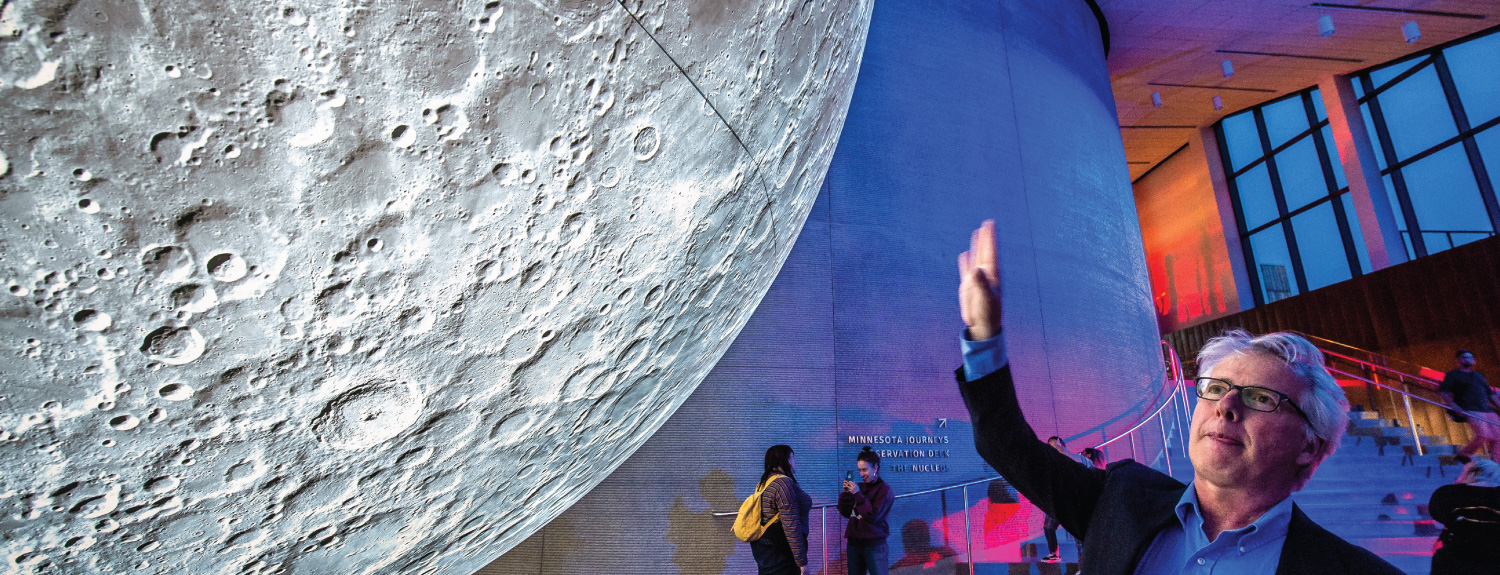 Guests viewing the Musuem of the Moon exhibit