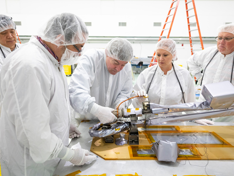 A team of scientists prepares the sensors for the Parker Solar Probe