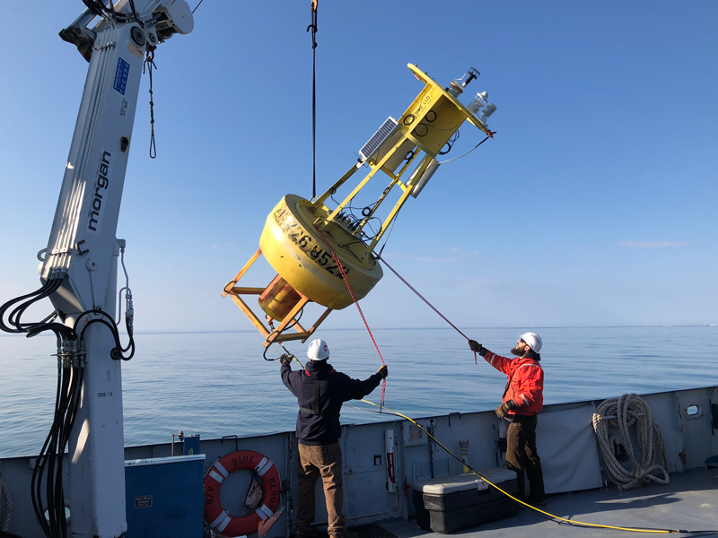 Large research buoy being lowered into Lake Superior