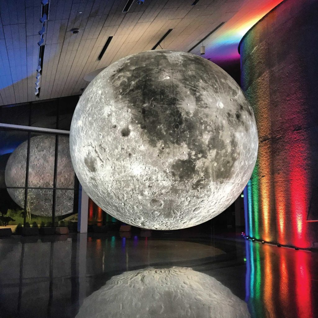 Musuem of the Moon backlit with rainbow colors