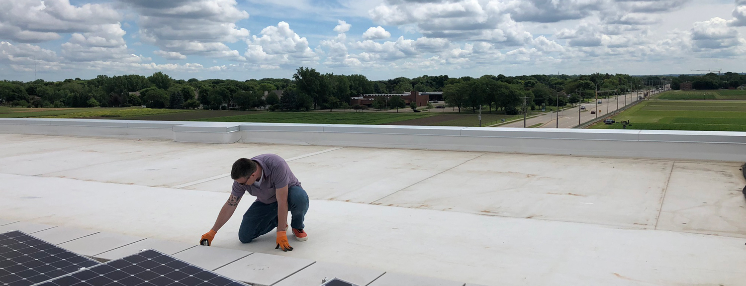Scott Peterson collecting possible micrometeorites from the Bell's rooftop.