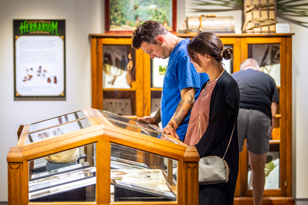 Visitors check out the Wicked Plants exhibit on opening weekend: A man and woman examine a display case