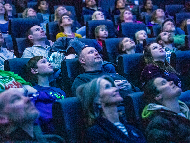 An audience in the Whitney and Elizabeth MacMillan Planetarium