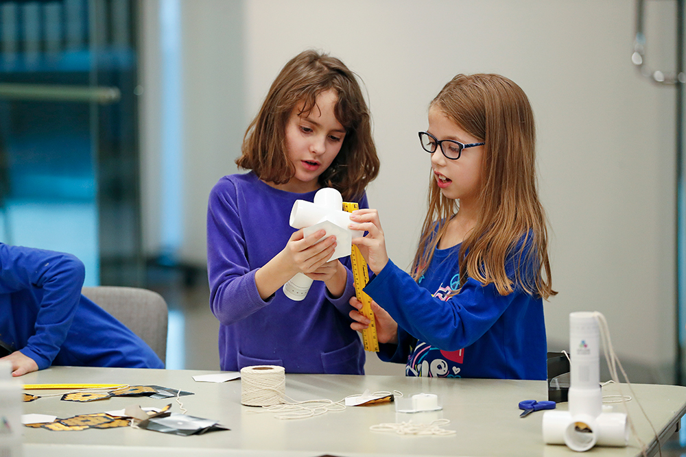 Two girls engineer a paper project