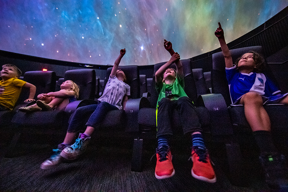 Visitors enjoy a planetarium show