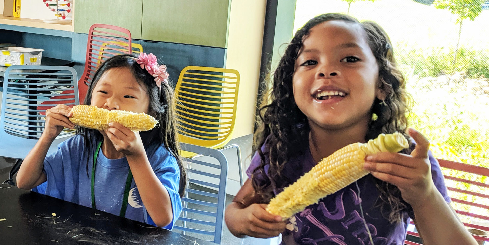 Summer campers eating corn at Farm Foodies