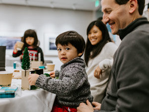 A family builds mini dioramas at the Bell