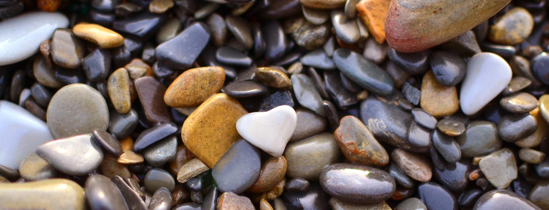 A heart-shaped rock among many other rocks