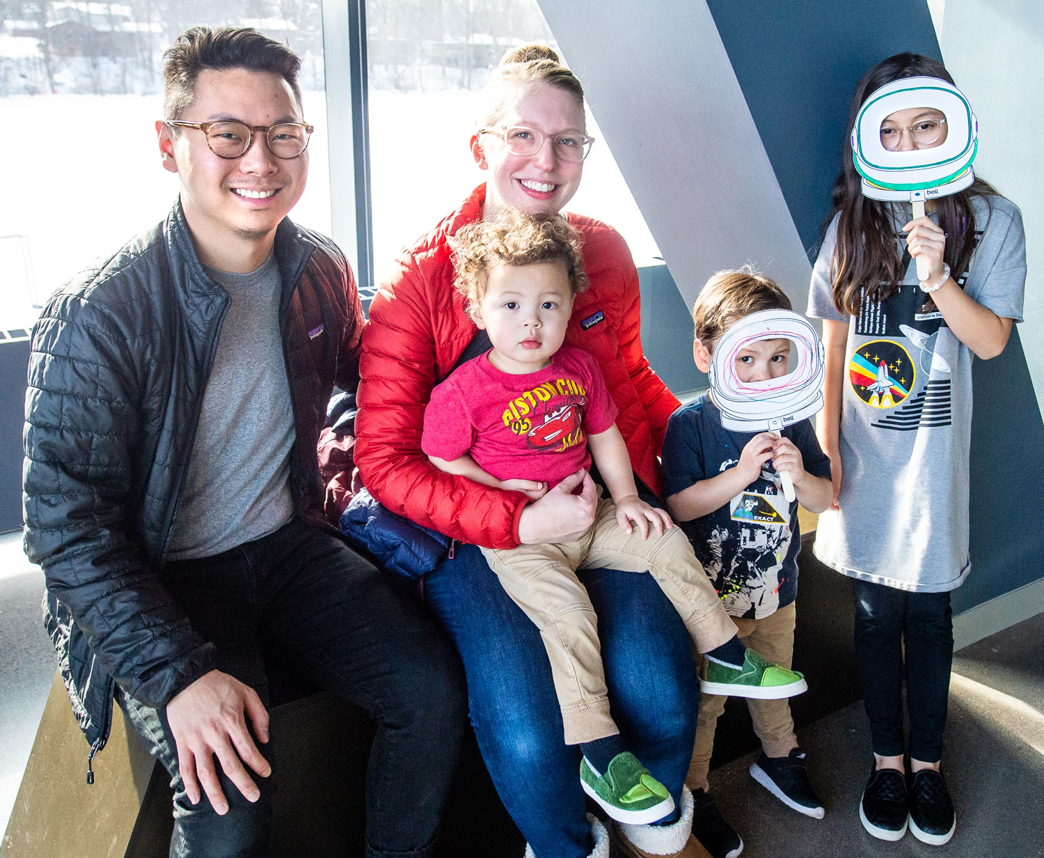 Family poses with their astronaut masks