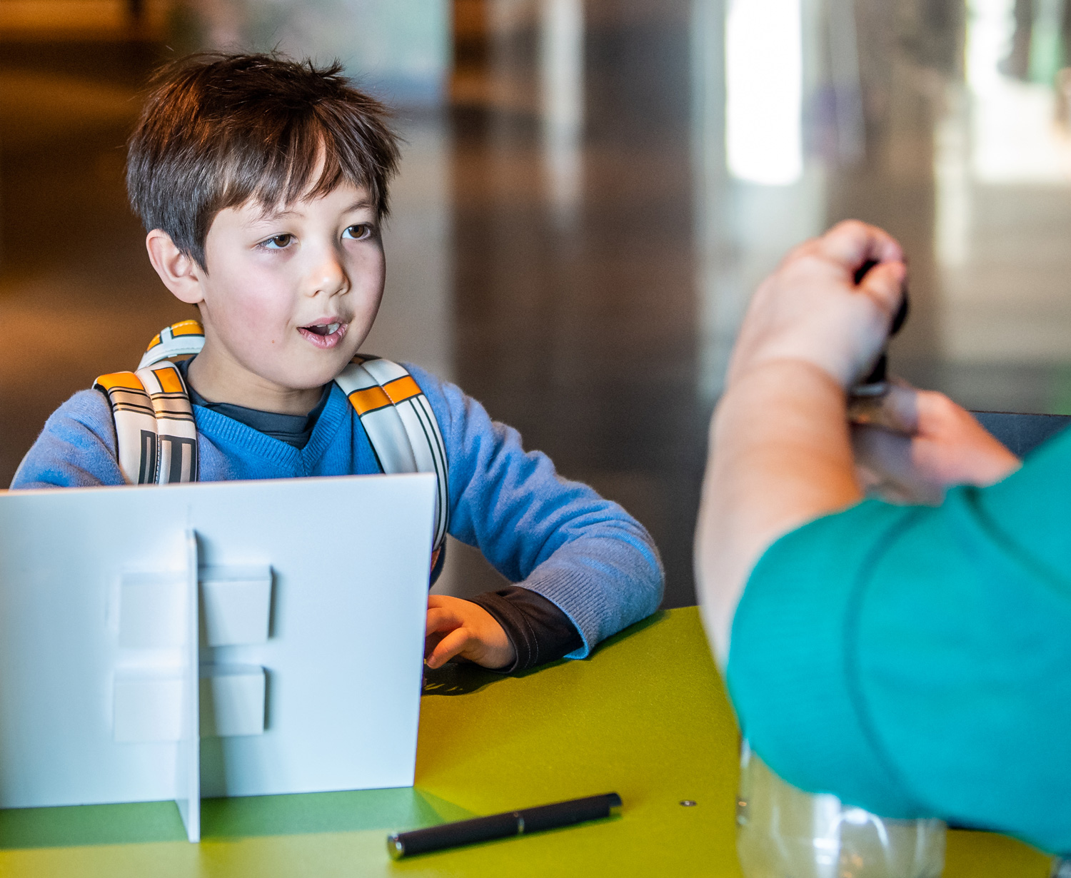 Young visitor learns about cloud formation