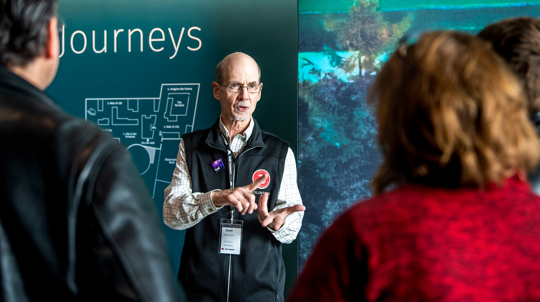 Bell Museum volunteer talks to attendees