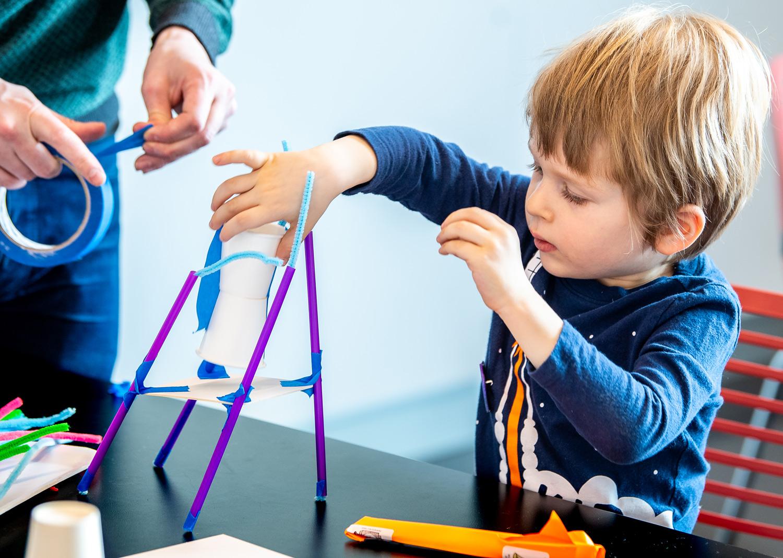 Young visitor builds lander