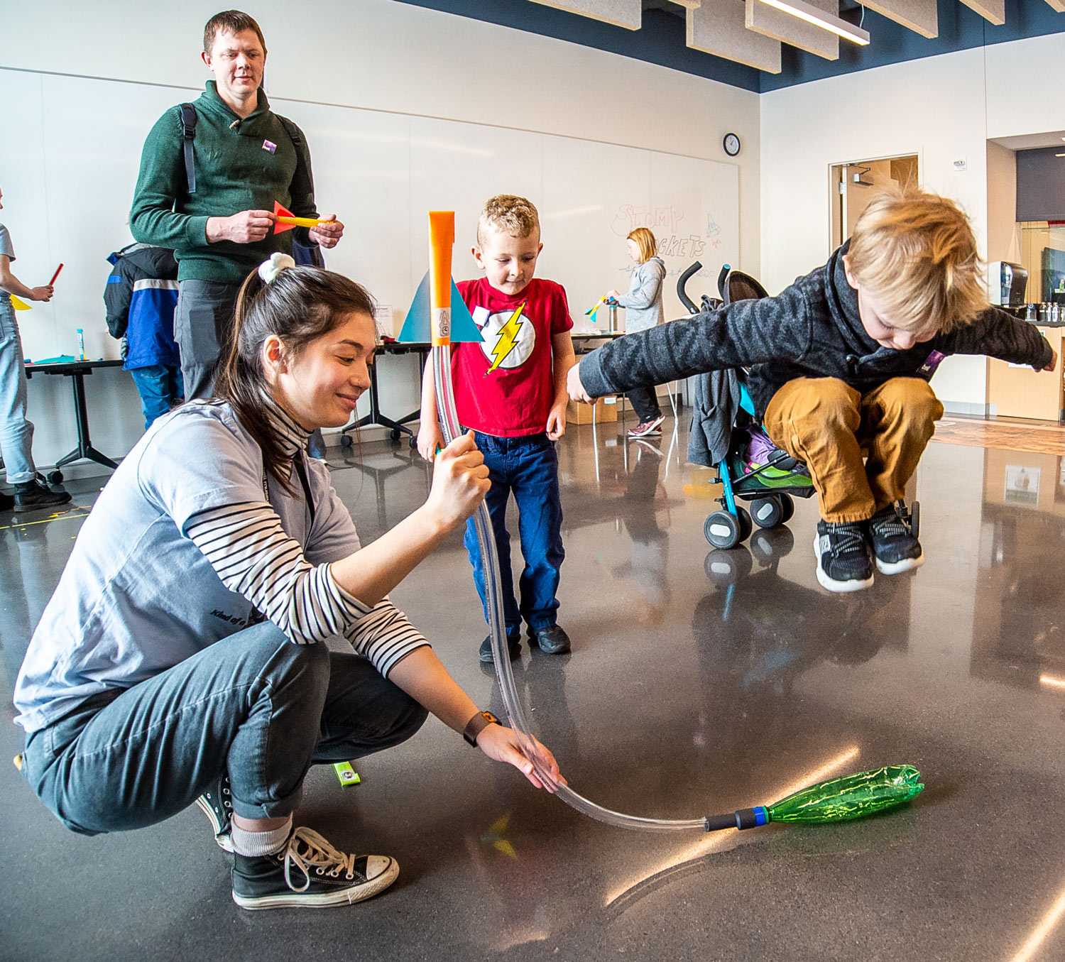 Young visitor jumps onto stomp rocket