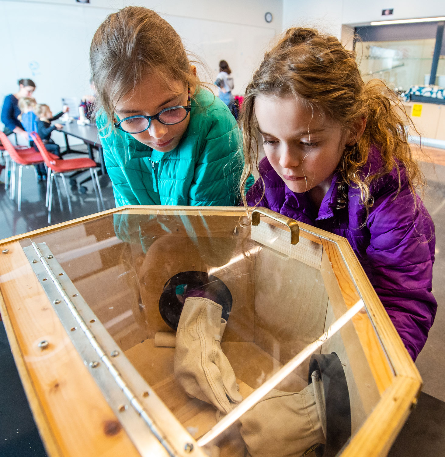 Two young visitors look through Astronaut Glove Box