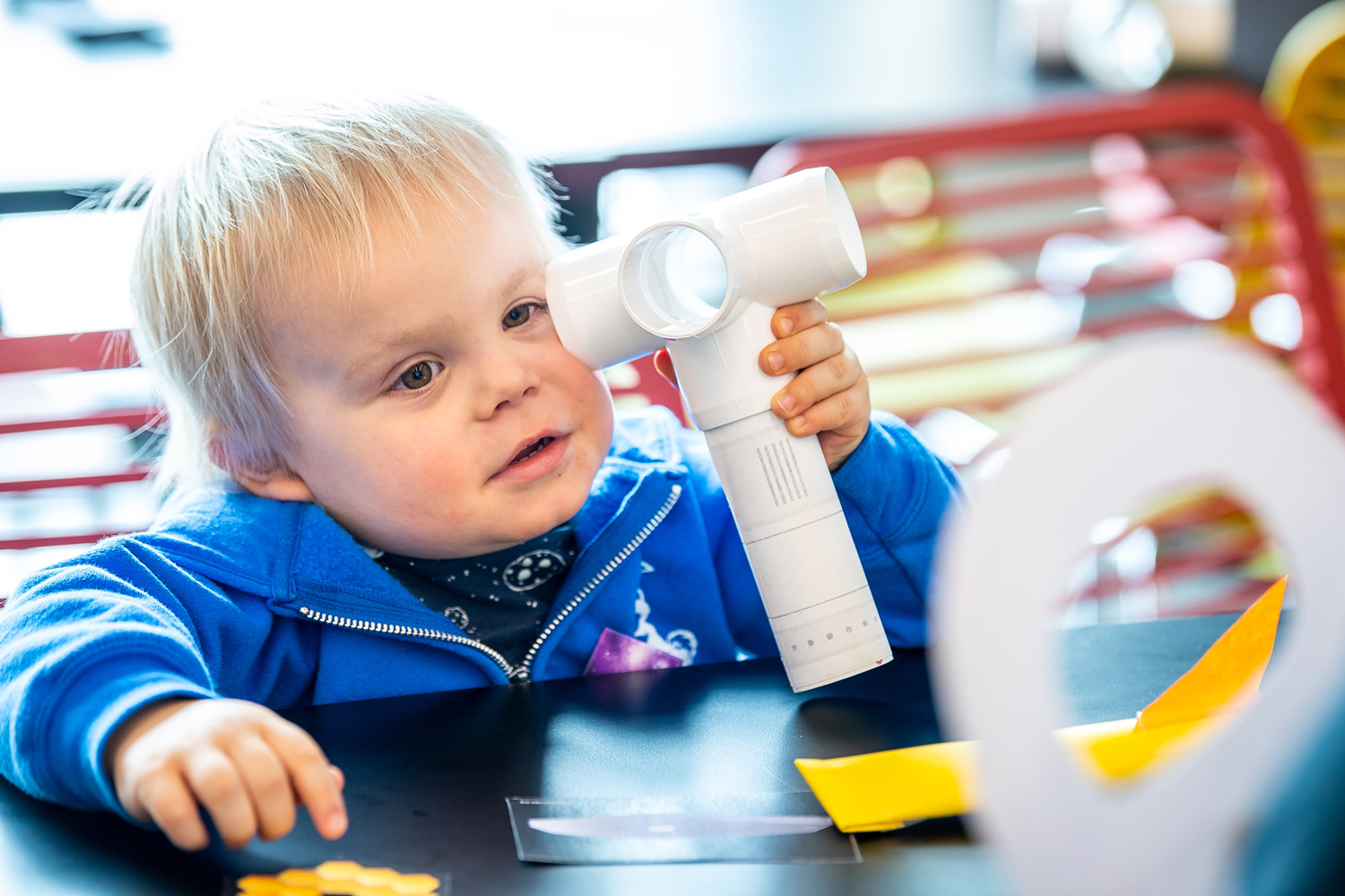 Young child plays with science activity