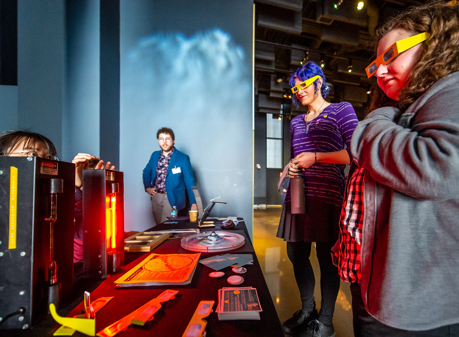 Students teach visitors about light wavelengths