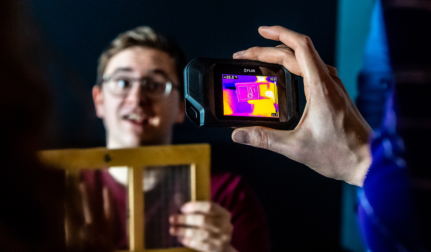 Student teaches visitors about thermal imaging