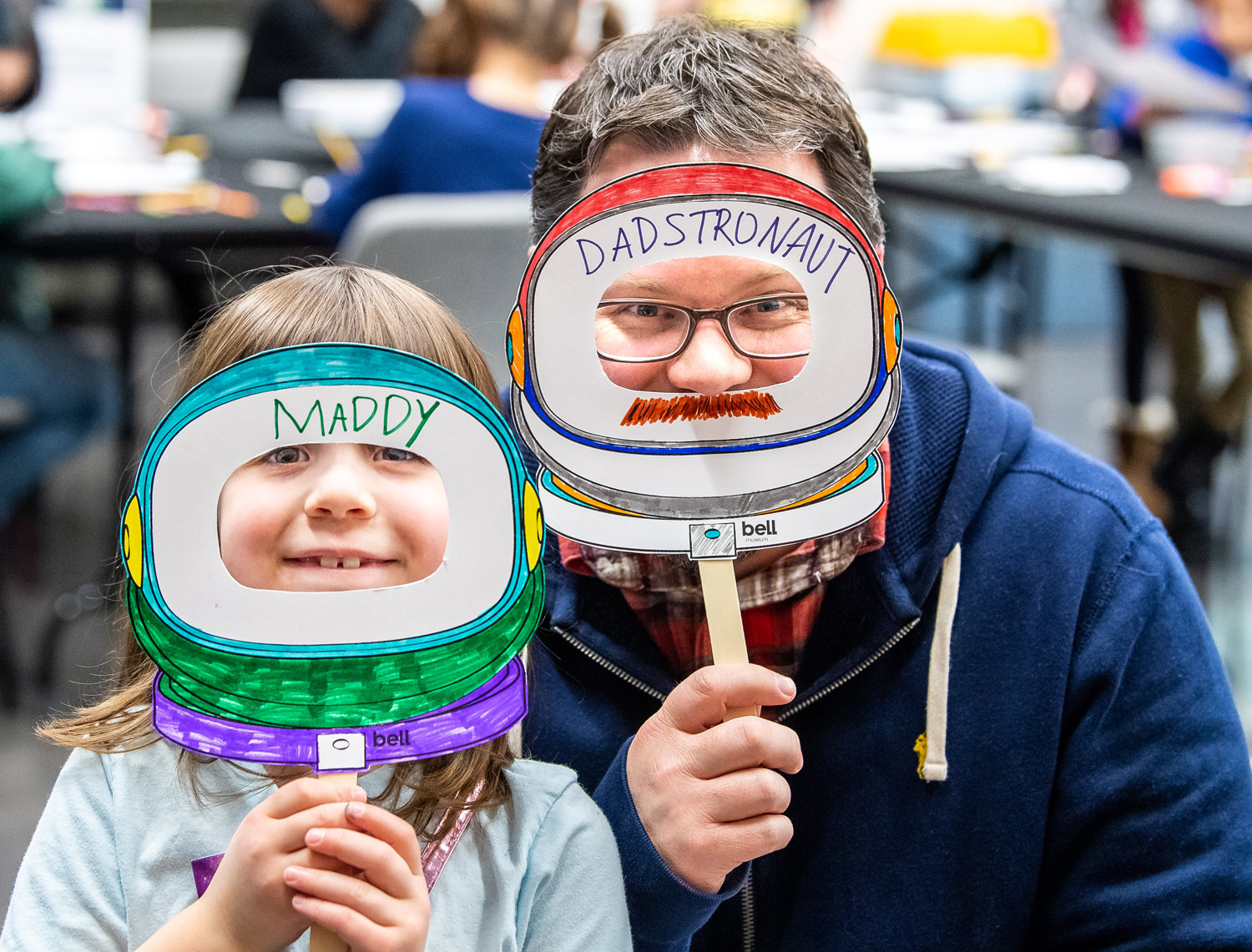 Visitors show off their astronaut masks