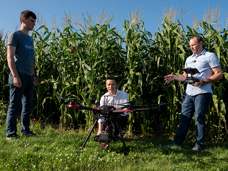 Three researchers with a drone