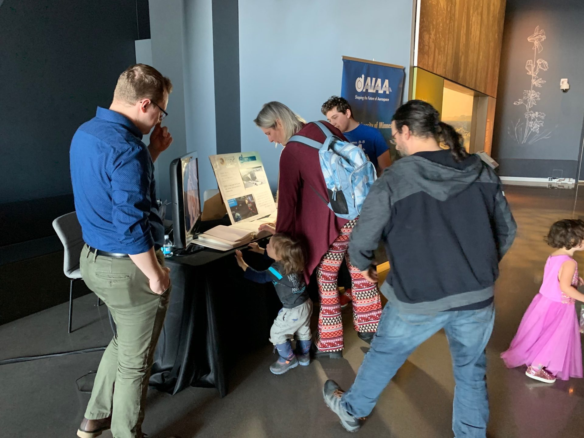 Visitors learn about a future lunar base from U of M student