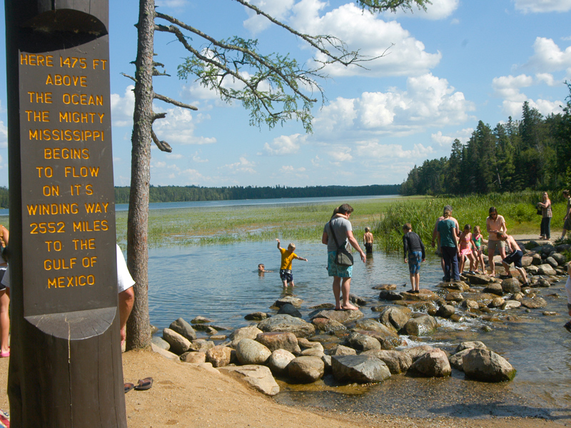 Visitors walk across the Mississippi's headwaters