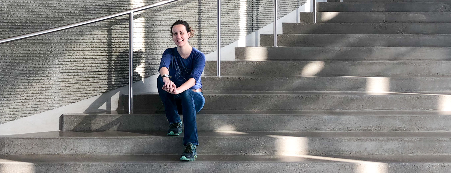Kaitlin Ehret sits on the stairs in Horizon Hall