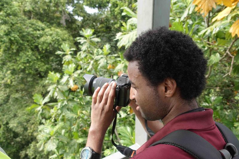 A researcher looks through binoculars