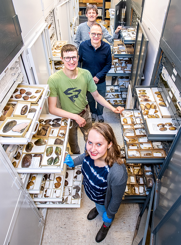 Collections curator Andrew Simons with Keiffer Williams, Alex Franzen, and Claire Rude in the mollusk collection