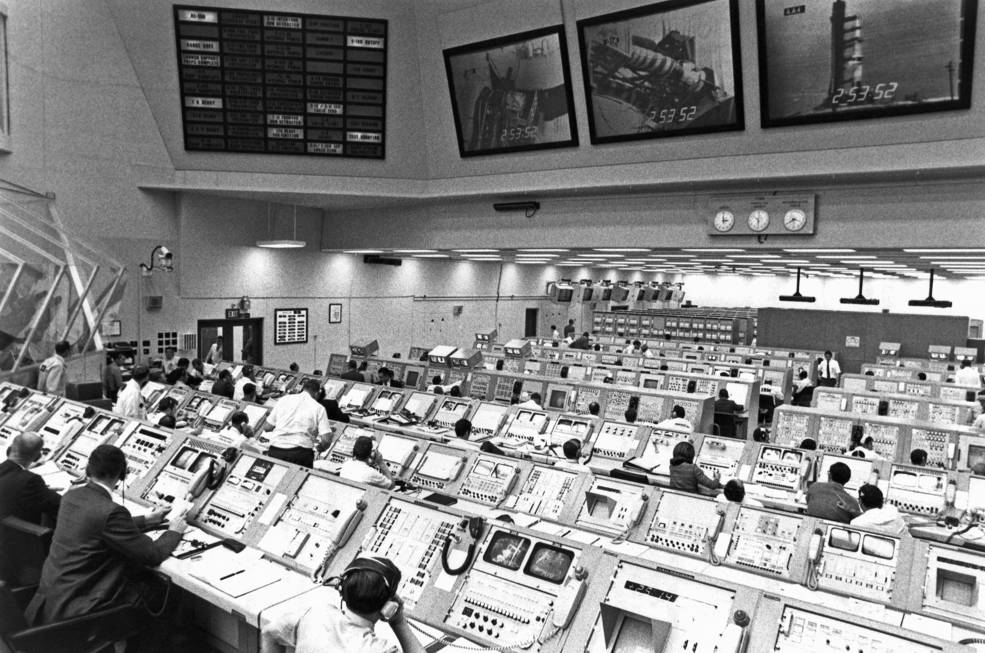 A black and white photo of the mission control room