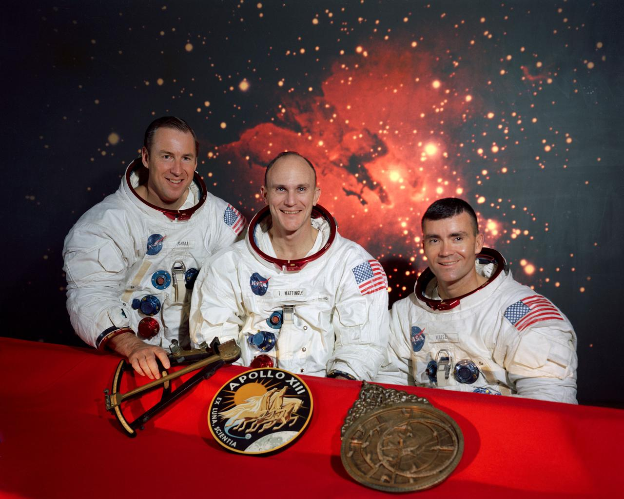 3 apollo 13 crew members posing in their neat space suits